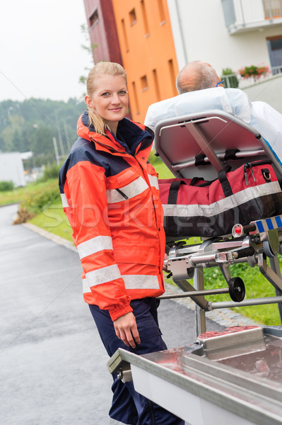 Patient on stretcher with paramedic emergency aid Stock photo © CandyboxPhoto