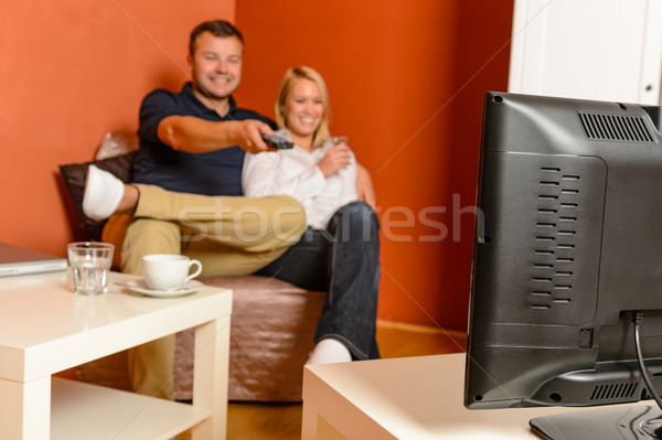 Happy couple watching tv evening changing channels Stock photo © CandyboxPhoto