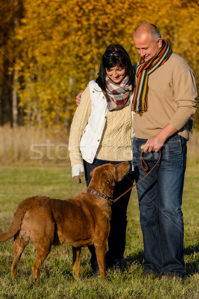 Couple with dog in sunny autumn park Stock photo © CandyboxPhoto