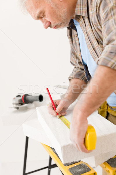 Home improvement - handyman measure porous brick Stock photo © CandyboxPhoto
