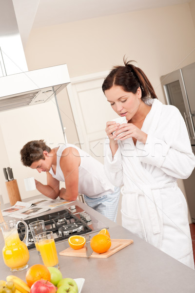 Stock photo: Happy couple having breakfast in the kitchen