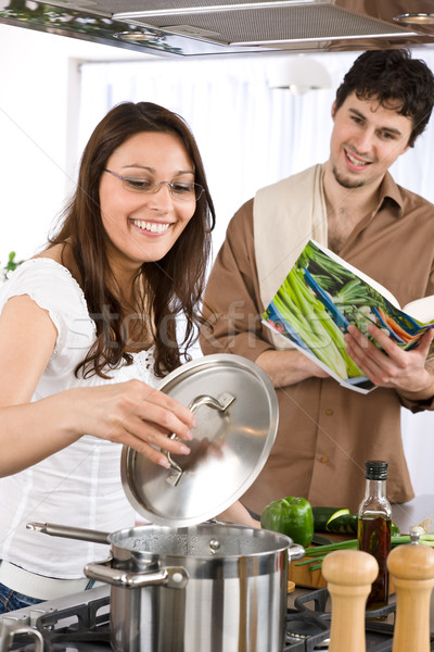 Happy couple cook together in modern kitchen Stock photo © CandyboxPhoto