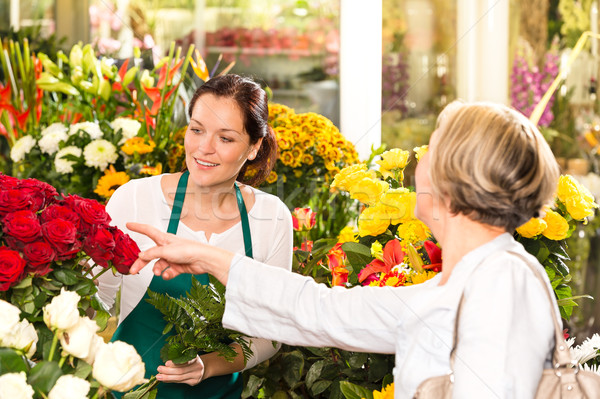 Senior customer buying red roses flower shop Stock photo © CandyboxPhoto