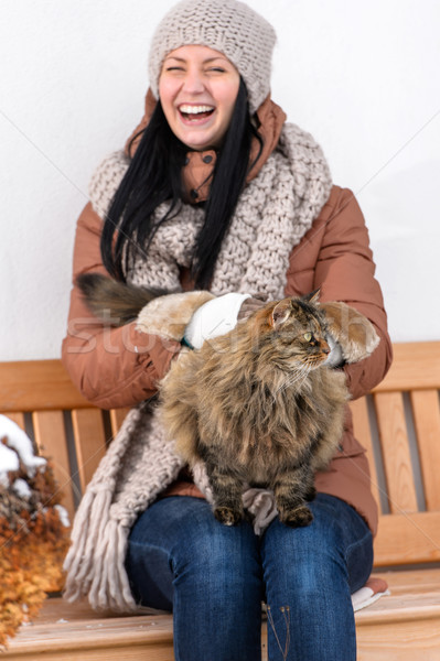 Young woman stroking cat sitting winter bench Stock photo © CandyboxPhoto