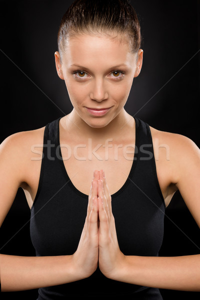 Portrait of smiling young woman performing yoga Stock photo © CandyboxPhoto