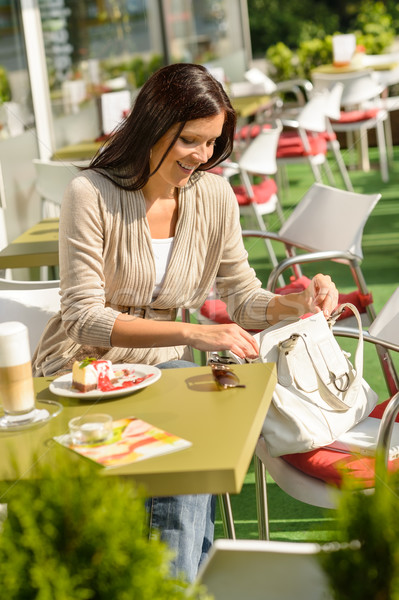 Woman looking in purse at cafe bar Stock photo © CandyboxPhoto