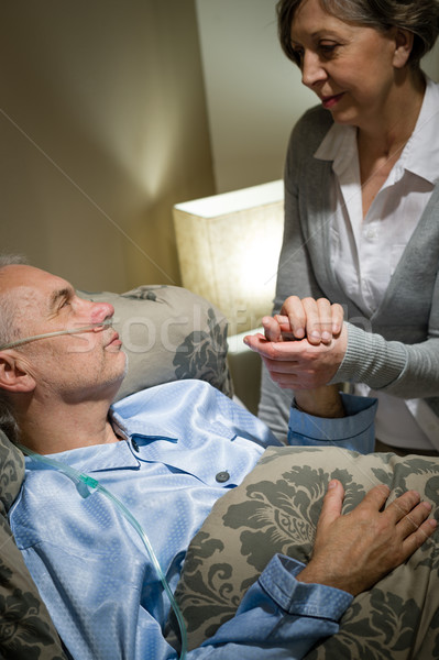 Old woman taking care of sick husband Stock photo © CandyboxPhoto