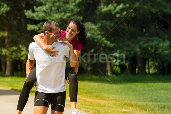 Fiúbarát háton barátnő sportos férfi boldog Stock fotó © CandyboxPhoto