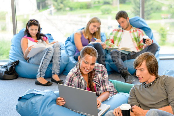 Students sitting on beanbags in study room  Stock photo © CandyboxPhoto