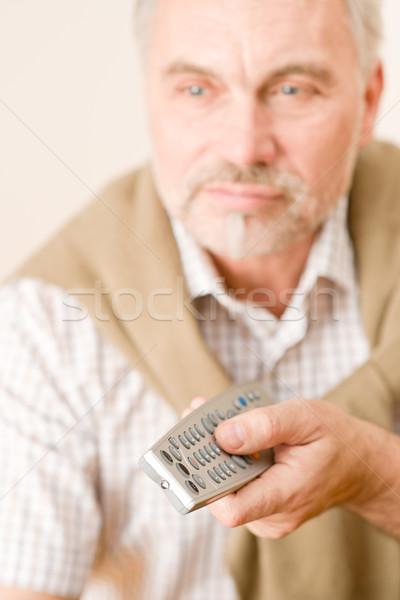Idős érett férfi távirányító tart kéz férfi Stock fotó © CandyboxPhoto