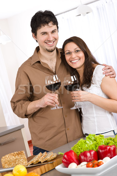 Happy couple drink red wine in modern kitchen Stock photo © CandyboxPhoto