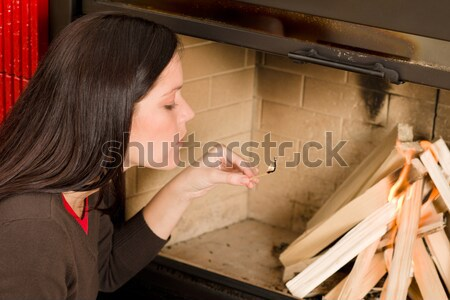 Home fireplace woman lighting up wooden logs Stock photo © CandyboxPhoto