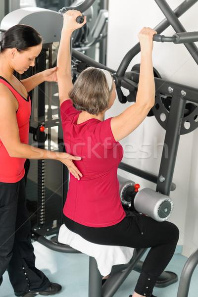 Fitness center trainer senior woman exercise back Stock photo © CandyboxPhoto