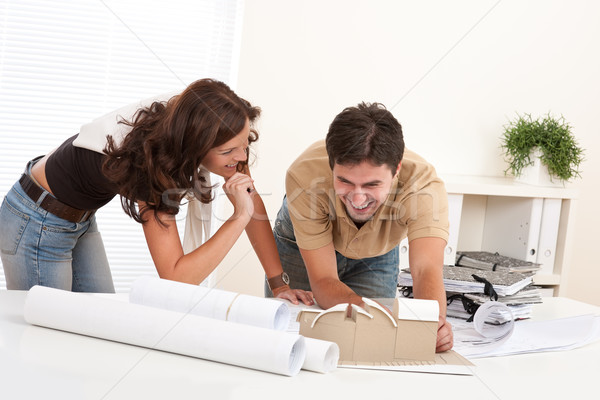 Stock photo: Young man and woman working at architect office