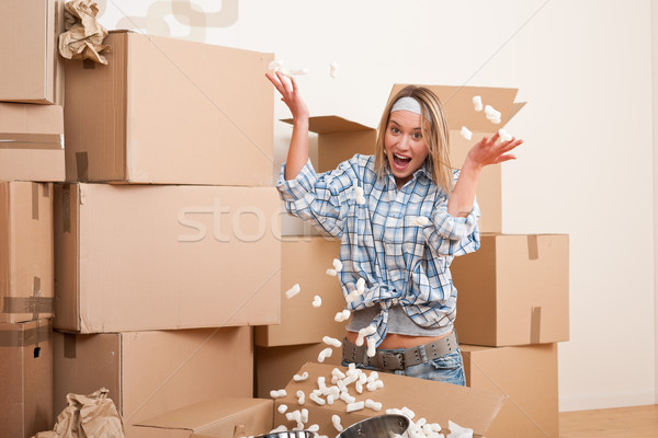 Moving house: Young woman having fun  Stock photo © CandyboxPhoto