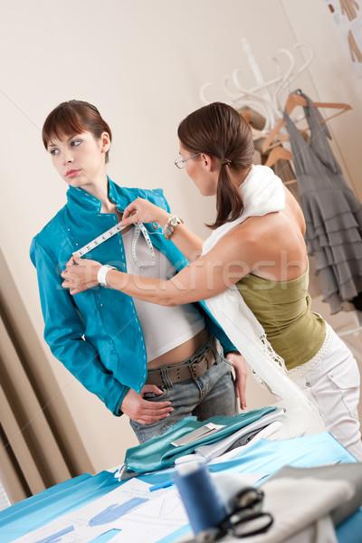 Female fashion designer measuring jacket on model Stock photo © CandyboxPhoto