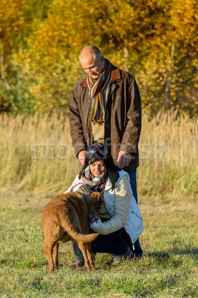 Couple playing with dog sunny autumn park Stock photo © CandyboxPhoto