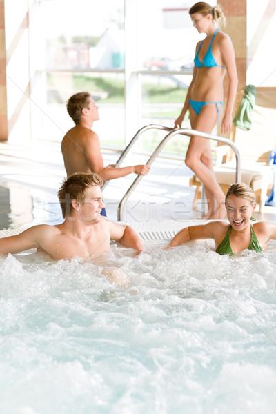 Piscina relaxar banheira de hidromassagem jovem atraente Foto stock © CandyboxPhoto
