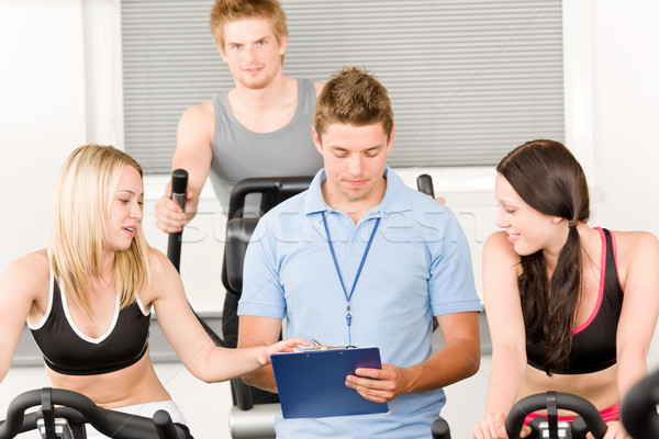 Young fitness instructor gym people spinning Stock photo © CandyboxPhoto