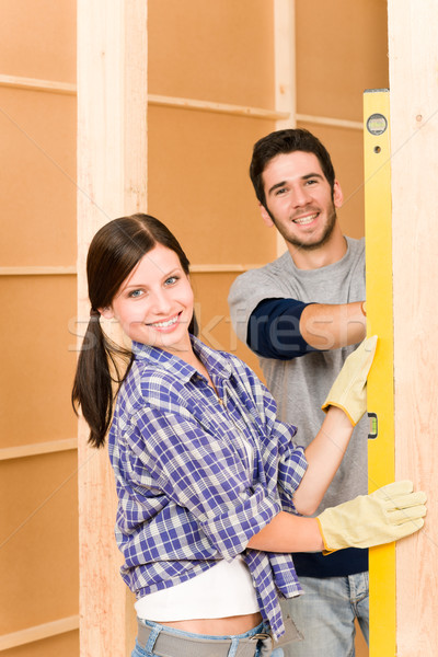 Home improvement glimlachend paar geest niveau Stockfoto © CandyboxPhoto