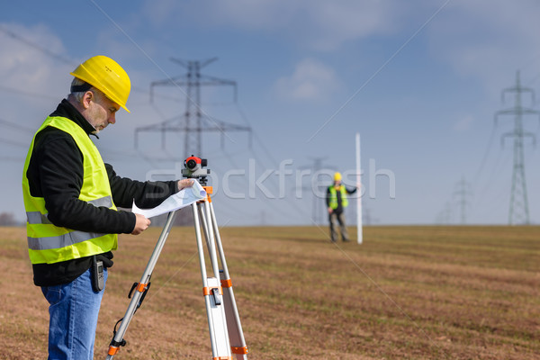 Geodesist measure land on construction site Stock photo © CandyboxPhoto