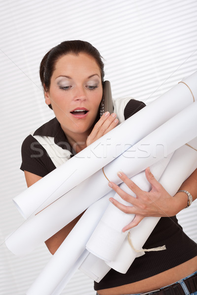 Young attractive female architect holding plans Stock photo © CandyboxPhoto