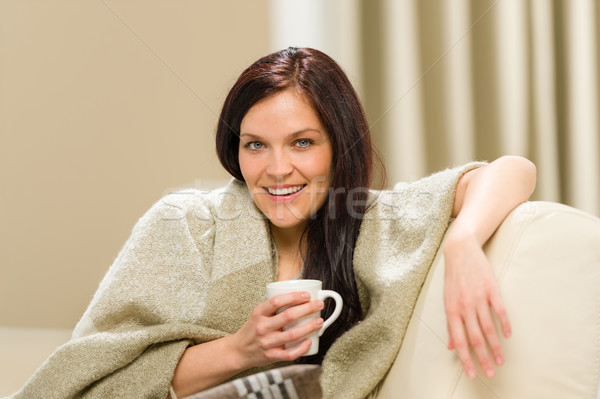 Joyful cozy woman drinking hot drink Stock photo © CandyboxPhoto