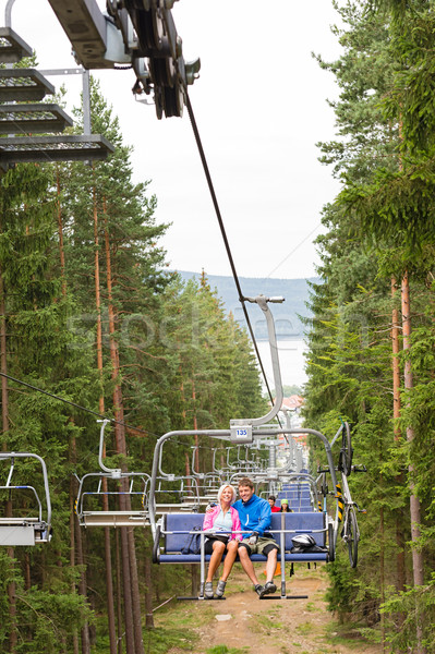 Young couple sitting on chair lift landscape Stock photo © CandyboxPhoto