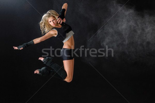 Dancer jumping while performing her dance routine Stock photo © CandyboxPhoto
