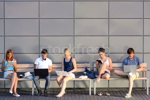 Students internet computer addiction sitting bench Stock photo © CandyboxPhoto
