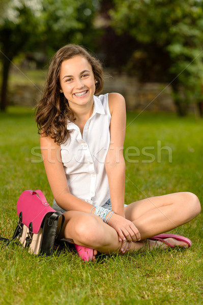 Cheerful student girl with briefcase sitting grass Stock photo © CandyboxPhoto
