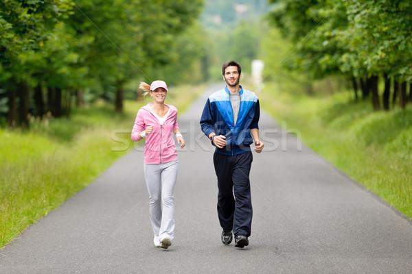Jogging fiatal pér fut park út fiatal Stock fotó © CandyboxPhoto