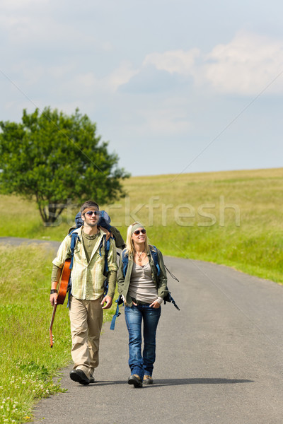 Hiking young couple backpack tramping asphalt road Stock photo © CandyboxPhoto