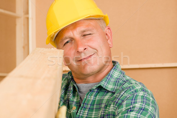 Handyman mature carpenter measure wooden beam Stock photo © CandyboxPhoto