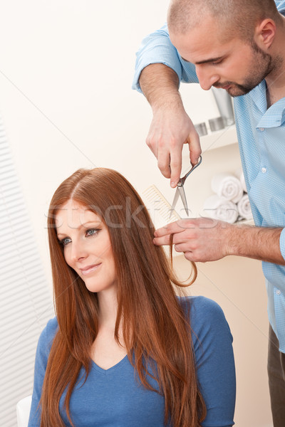 Stock photo: Professional hairdresser cut with scissors at salon