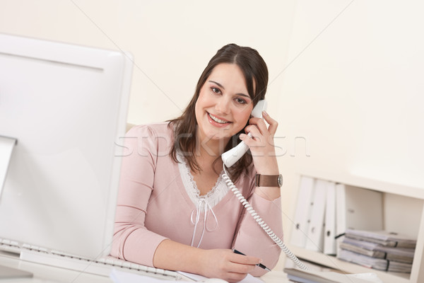 Young secretary on phone at modern office Stock photo © CandyboxPhoto