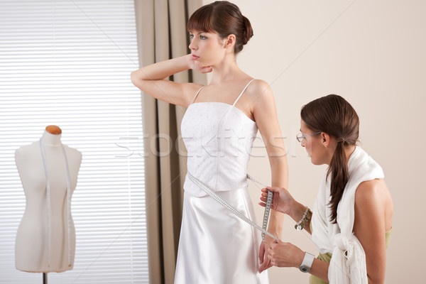 Fashion model fitting white wedding dress by designer Stock photo © CandyboxPhoto