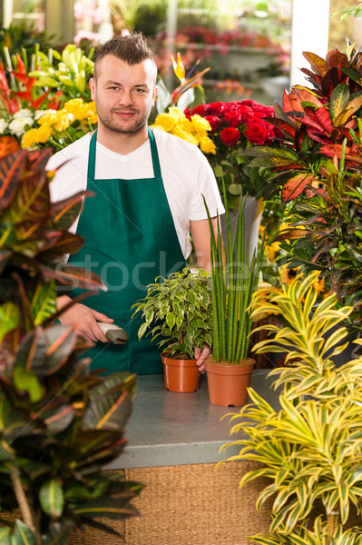 Young man scanning barcode flower shop gardening Stock photo © CandyboxPhoto