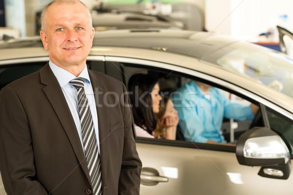 Közelkép portré autókereskedő néz kamera állás Stock fotó © CandyboxPhoto