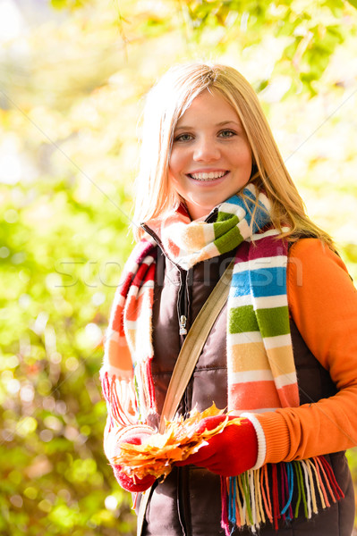 Smiling blonde girl collecting dry leaves woods Stock photo © CandyboxPhoto