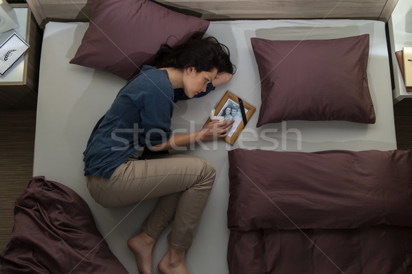 Young mourning woman lying in bed  Stock photo © CandyboxPhoto