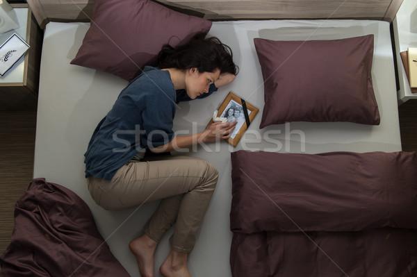 Fiatal gyász nő ágy egyedül szomorú Stock fotó © CandyboxPhoto