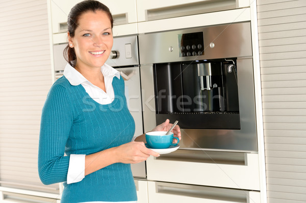 Smiling woman drinking cappuccino kitchen machine cup Stock photo © CandyboxPhoto
