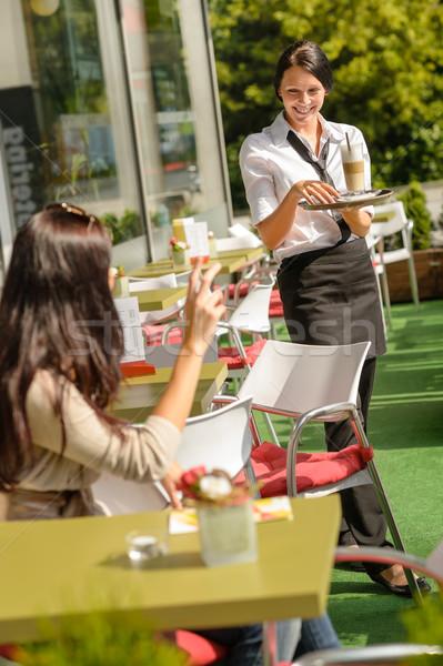 Waitress bringing woman coffee order restaurant Stock photo © CandyboxPhoto