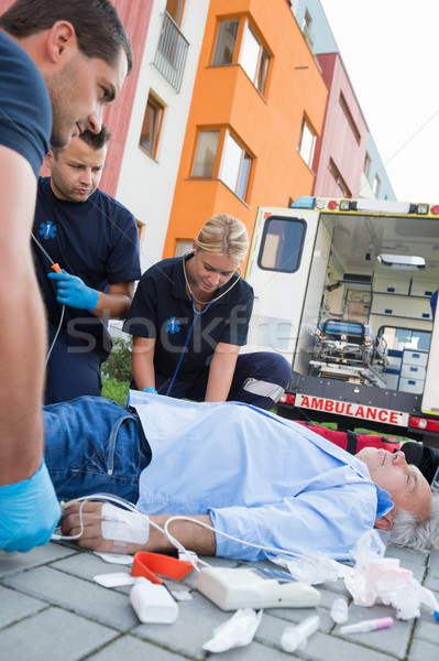 Emergency team examining injured patient on street Stock photo © CandyboxPhoto