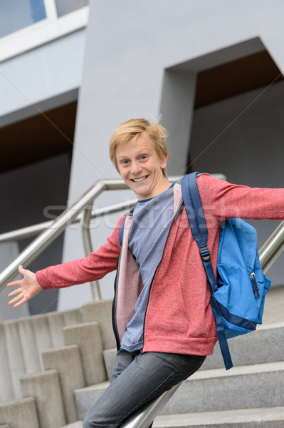 Excited student sliding down railing on stairway Stock photo © CandyboxPhoto