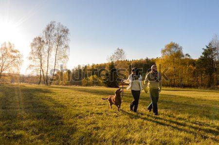 Couple walking dog autumn sunset landscape Stock photo © CandyboxPhoto