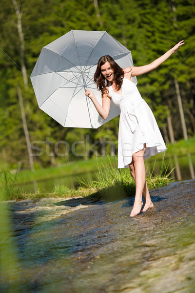 Happy romantic woman with parasol in sunlight  Stock photo © CandyboxPhoto