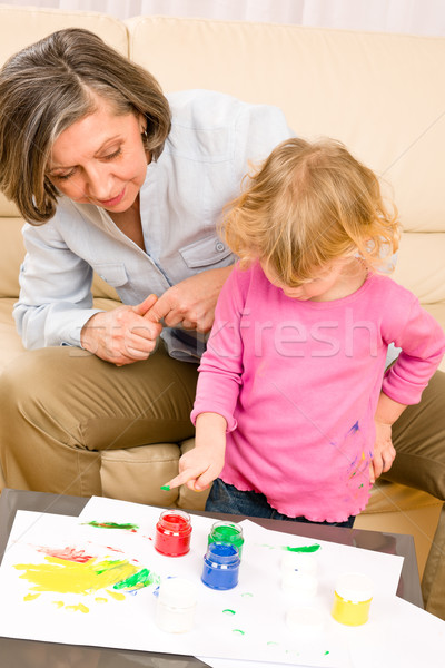 Little girl with grandmother play paint handprints Stock photo © CandyboxPhoto
