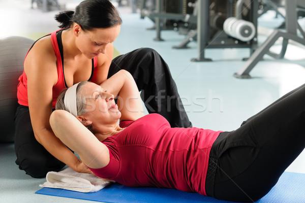 Senior donna esercizio addominale fitness centro Foto d'archivio © CandyboxPhoto